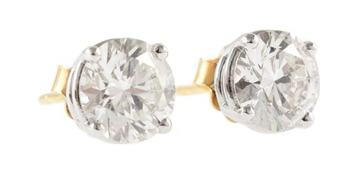 54 - Pair of diamond solitaire 18ct gold stud earrings