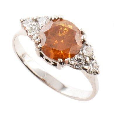 Lot 87-Fancy deep yellow-orange diamond solitaire ring